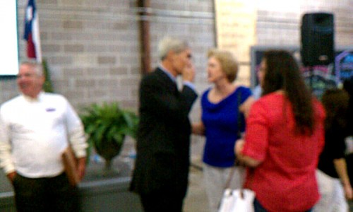 Mike Anderson whispers to Patricia Pollard at the King Street Patriots DA debate in 2012