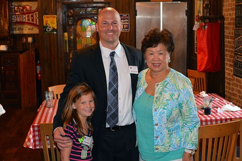 Dr. Martha Wong with candidate for judge of the 247th District Court John Schmude and helper Allie