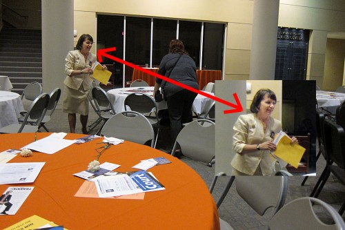 Judge Denise Pratt picking up negative flyers at the HCRP Executive Meeting.