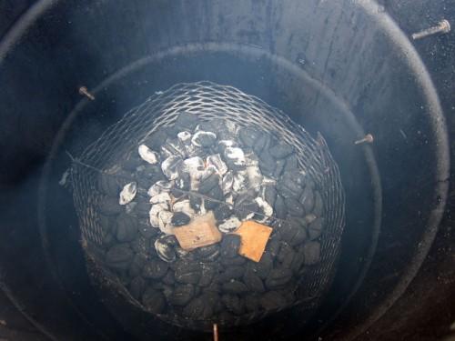 Hot coals dumped in basket.