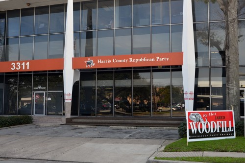 Re-elect Jared Woodfill sign in front of Harris County Republican Party headquarters.